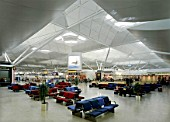 Waiting area in Stansted Airport terminal building. United Kingdom. Designed by Foster and Partners.