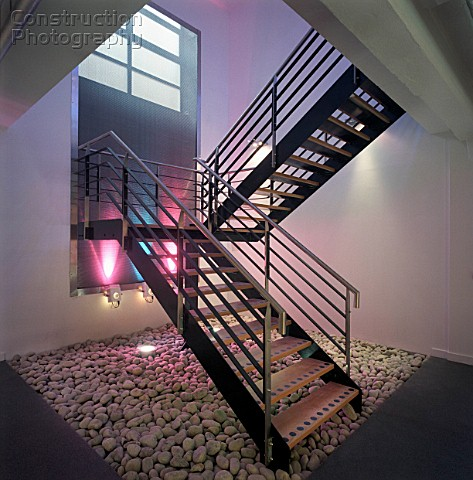 Modern Steel Staircase Lit By Coloured Spotlights