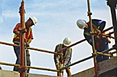 Construction workers erecting a scaffolding