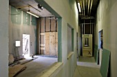 Interior of an office block under construction, View of stud partition walls.