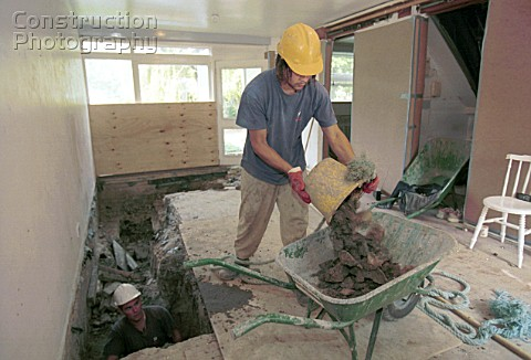 Underpinning Excavating with bucket and spade inside a house