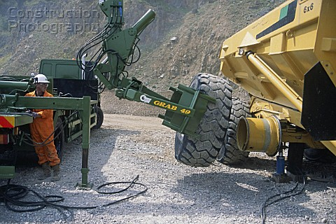 A008-00477: Mechanic changing tyre on heavy duty articul ...