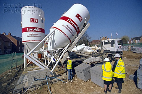 Concrete batching Cement Silo being delivered on a property development site