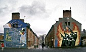 Murals on ends of terraced housing. Bogside, Londonderry, Northern Ireland, United Kingdom.