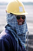 Thai workers nearly always use woollen face protection against the tropical sun