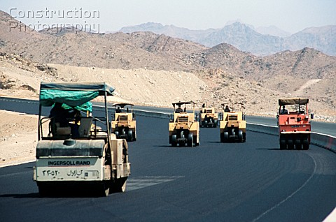 Steamrollers rolling asphalt during road construction near Medina Saudi Arabia