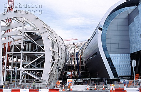 A012-01348: Curved steel frame is worked on from a varie ...