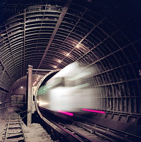 London Underground train entering tunnel during refurbishment of Angel Underground station London Un