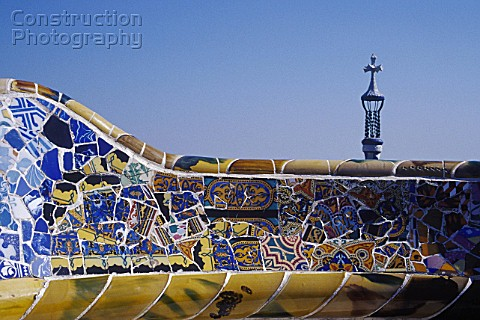 Detail of ceramic tiled mosaic wall at Parc Guell Barcelona Catalunya Spain Designed by Antoni Gaudi