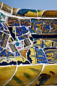 Detail of ceramic tiled mosaic wall at Parc Guell, Barcelona, Catalunya, Spain. Designed by Antoni Gaudi.