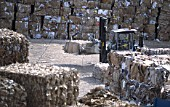 Paper and cardboard bales at Smurfit waste recycling centre and paper mill. Snodland, Kent, United Kingdom.