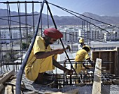 Indian Sikh construction worker in Oman working on a housing development in Oman, Middle East.