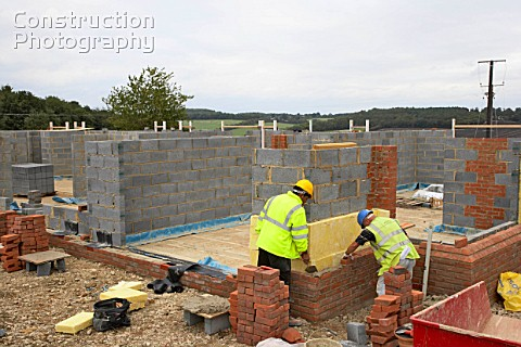 Bricklayers On A House Building Site England UK