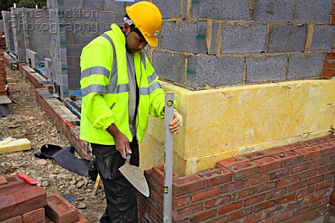 Bricklayer on a house building site England UK