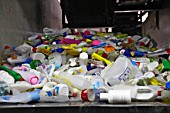 Plastic recycling on conveyor belt at recycling centre