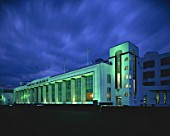Facade of the art deco Hoover Building at night. Western Avenue, Ealing, London, United Kingdom. Building designed by Wallace Gilbert and Partners.