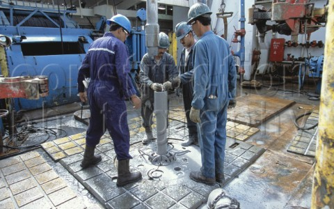 Oil workers on drilling floor of a drilling rig in the Caspian Sea Azerbaijan