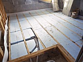Floorboard insulation with polystyrene sheets and underfloor heating