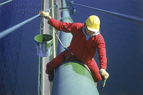 Man Painting Cable of Suspension Bridge