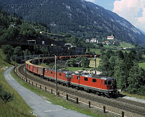 Freight train on Saint Gotthard railway track Swiss Alps Canton of Uri Switzerland