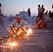 Shipbreakers of Chittagong, Bangladesh, Asia. Welding on the beach.