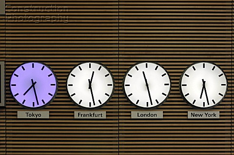 Four clocks showing time zone on the four world leading financial cities