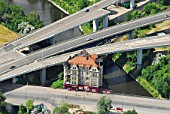 The A100 motorway is built around a 1910 built house, Rattenburg, Berlin, Germany, aerial view