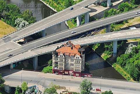 The A100 motorway is built around a 1910 built house Rattenburg Berlin Germany aerial view