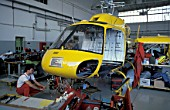 Yellow Helicopter under going maintenance.