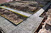 Groundwork for house building. Trench reinforced with steel and concrete plastic spacers.
