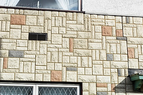 Artificial stone facade on a wall of a house Ipswich UK