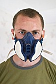 Man wearing breathing mask, close up