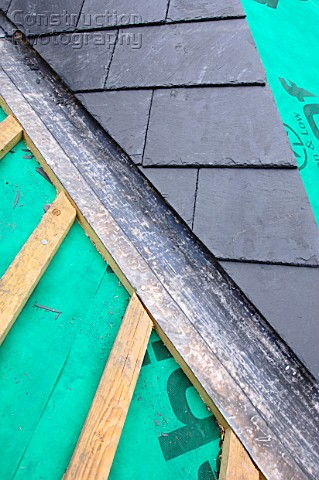 A062 00463 Section Of Slate Roof Under Construction Sho