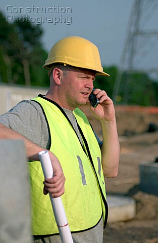 building technician making a phone call on site