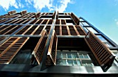 Residential development with wood shutters and timber cladding. Manchester, England, UK