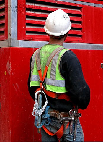 A077-00077: Back view of site worker in safety harness w ...