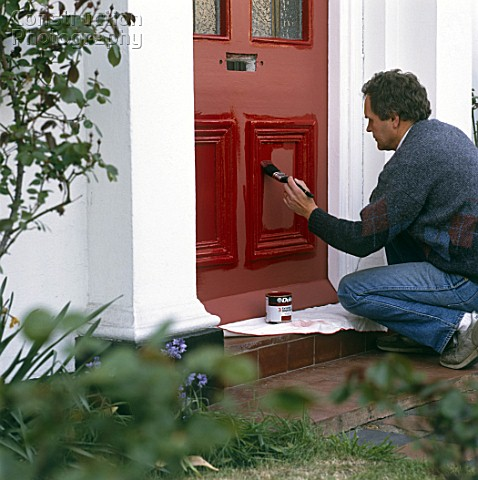 Painting A Front Door With Bright Red Paint