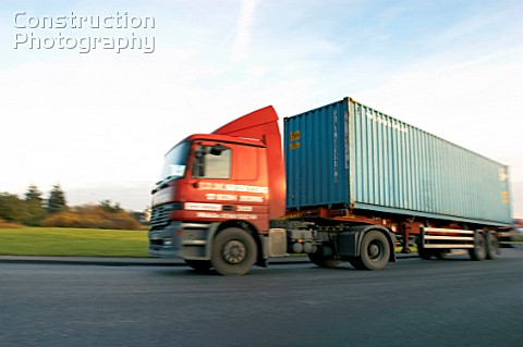 A088-00701: Articulated container truck on the road ...