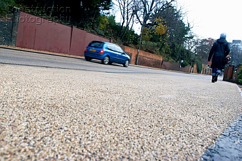 Coloured asphalt applied on road crossing England UK