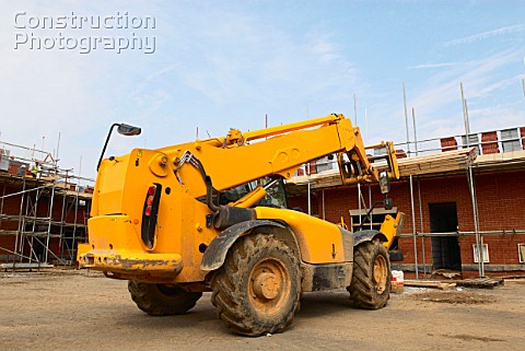 Rear view of forklift on house building site