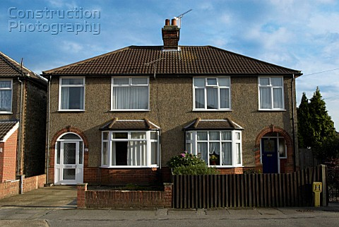 Semidetached houses covered with pebble dash England UK