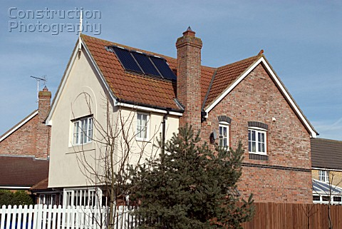 House fitted with solar panels on pitched roof England UK