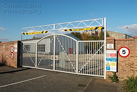 Barrier gate at with a height restriction at an entrance to a factory Stowmarket UK