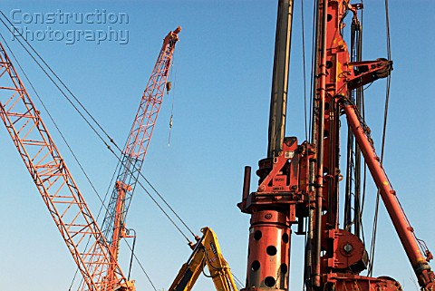 Piler and various crane arms on a construction site London UK