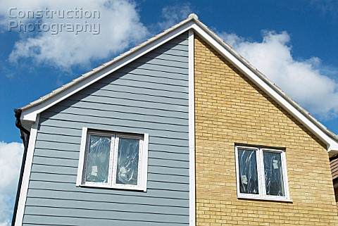 Weatherboarded new homes under construction Ipswich UK