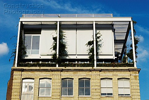 Rooftop modern extension with window blinds Old Street London UK