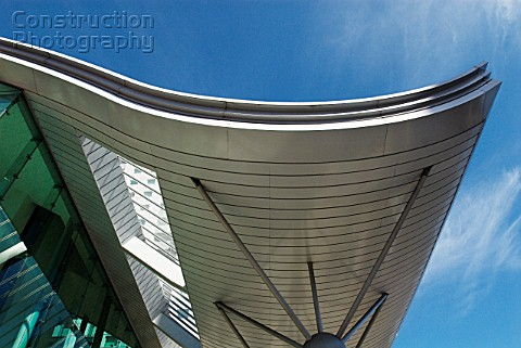 Curved roof entrance to modern apartments South London UK
