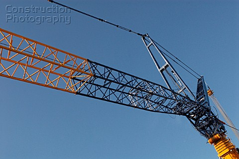Unmanned crane on Westfield Shopping Centre construction site White City West London UK