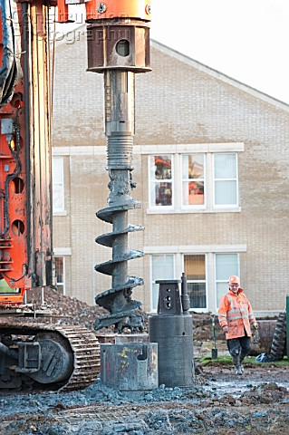 Auger drill rig drilling foundations on housing development UK