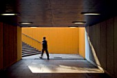 View of underpass and stairwell on Londons south bank including blurred figure, UK